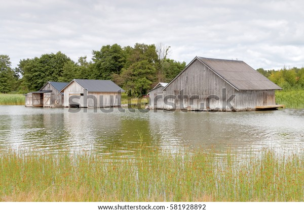Gray decayed boathouses sea and weed in the archipelago in Aland, Finland
