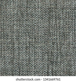 Gray denim textile textured background. Vintage jeanse fashion background for designers and composing collages. Luxury textured genuine fabric of high and natural quality.