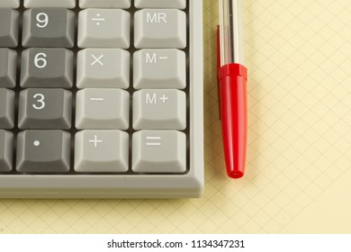 gray digital calculator for calculations  close-up on background