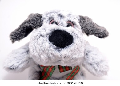 gray dog doll isolated on white
