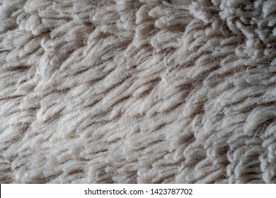 The gray fabric of the blanket
