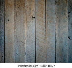 Gray faded reclaimed wood surface with aged boards. Wooden planks with grain and texture. Neutral flat vintage wood background.