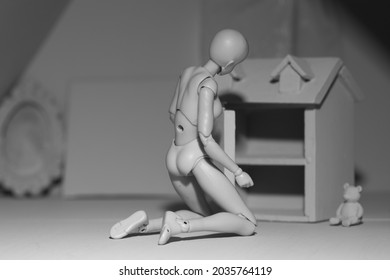 Gray figure within her home