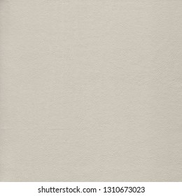 Gray, gentle, light leather background. Vintage fashion background for designers and composing collages. Luxury textured genuine leather of high quality.
