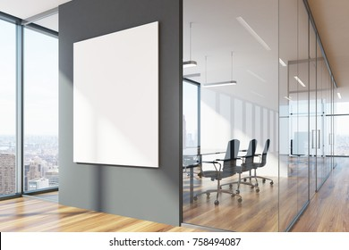 Gray and glass office waiting area with loft windows, a wooden floor, a vertical poster and a meeting room with black chairs. 3d rendering mock up
