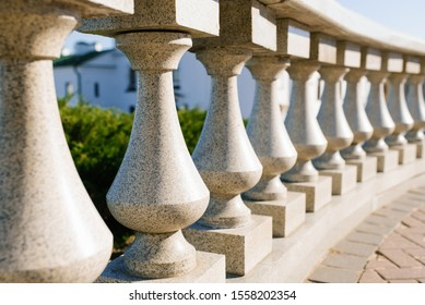 Gray granite balusters as fencing in the city