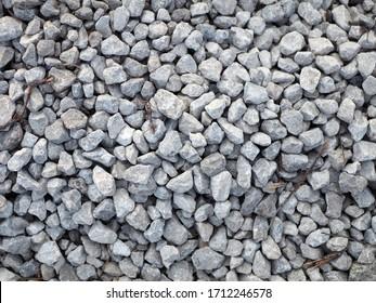 Gray gravel background - small stones. Stone aggregate