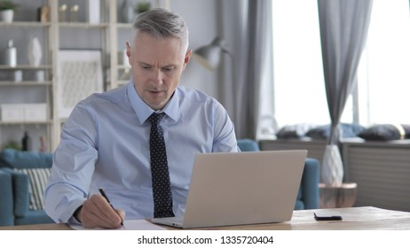 Gray Hair Man Sad for Failure while Working on Laptop