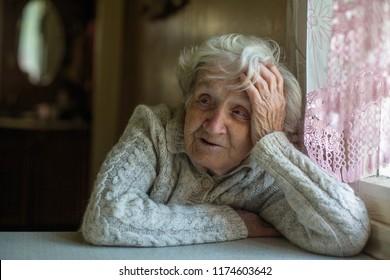 Gray haired elderly grandma portrait.