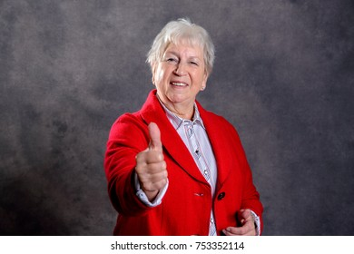 gray hairy elderly woman showing thumb up