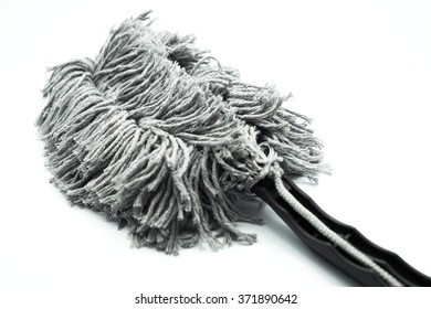 Gray hand cotton duster for cleaning a car, isolated on white background. Space for texts.