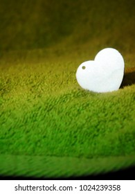 Gray heart on a green background