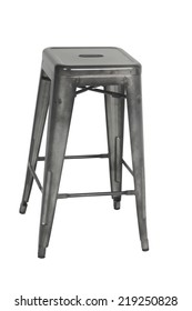 A gray industrial looking stool on a white background