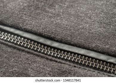 gray jersey textile dress with zipper detail