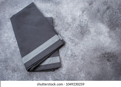 Gray Kitchen Towel on Gray Stone Table Background. Top view with copy space