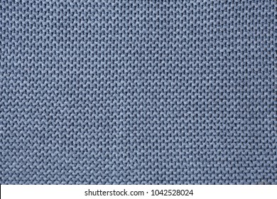 Gray knitting wool texture background. Place for text