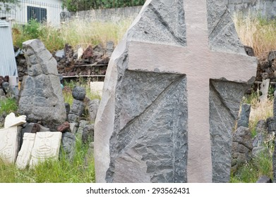 Gray lava stone sculpture of a christian cross