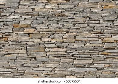Gray Layered Stone Brick Wall Background