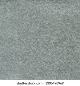 Gray leather textured background. Vintage fashion background for designers and composing collages. Luxury textured genuine leather of high quality.