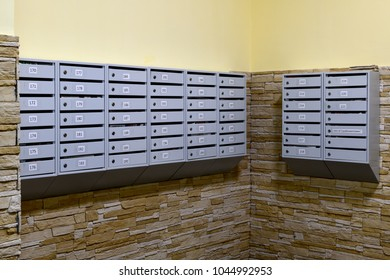 gray mailboxes in corridor of the apartment building