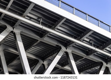 Gray metal framework of the bridge. Industrial construction