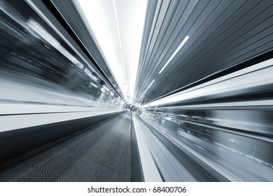 gray metal moving way, escalator in airport