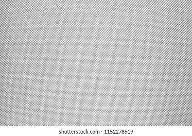Gray metal plate with many small holes