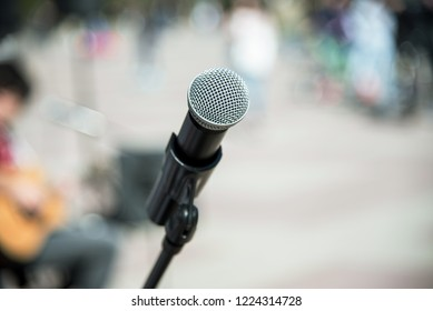 gray microphone in focus on a blurred background. protest. acoustic concert. political demonstration.
