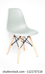 Gray modern chair with wooden legs isolated on white background