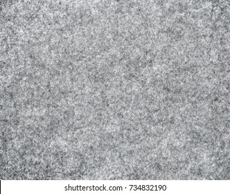 Gray natural felt as background, top view