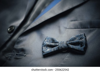 Gray necktie - a butterfly resting on the suit.