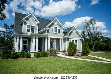 Gray New Construction Modern Cottage Craftsman Home with Hardy Board Siding and Teal Door with Curb Appeal