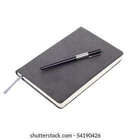 Gray notebook with pen