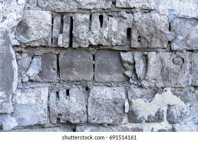 Gray old brick broken wall