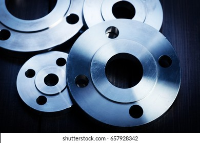 Gray on the background of cast iron flanges