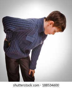gray osteochondrosis teenage holds boy teenager his hand behind his back back pain emotion