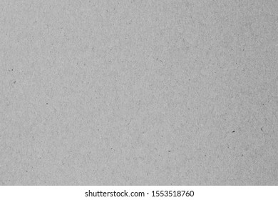 Gray paper, cardboard, craft sheet. Wrapping paper texture, pattern. Natural surface of packaging.