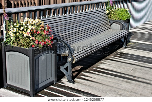 Astonishing Gray Park Bench Boardwalk Planter Boxes Stock Photo Edit Pabps2019 Chair Design Images Pabps2019Com
