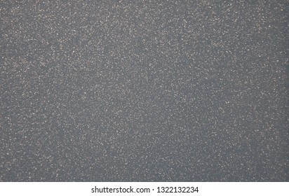 Gray pearlescent transparent background with metal splashes. Background. Texture. Close-up.