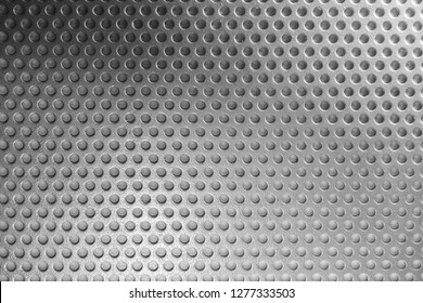 Gray perforated metal plate. Aluminum texture.
