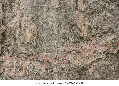 Gray and pink mottled rockface, in the Hebrides Islands, Scotland.
