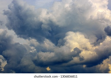 Gray rainy sky with big clouds. Nature background.