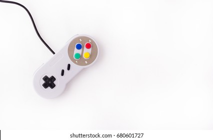Gray retro joystick on a white background. Video game console GamePad on a white background. Top view