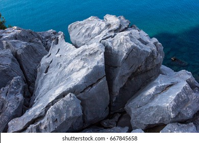Gray rocks and sea texture background