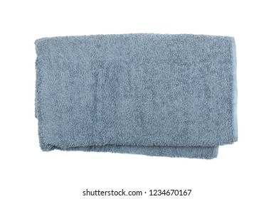Gray rolled or folded hotel towel isolated on white close up. New terry cotton towels or soft washcloth top view