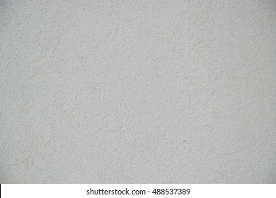 Gray roughcast texture.