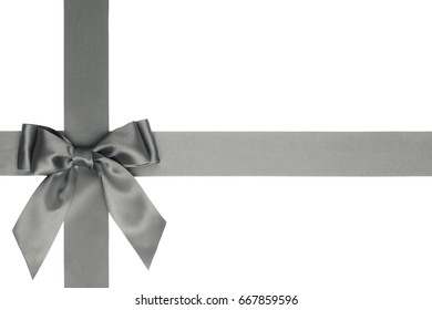 Gray satin ribbon with gift bow with tails on white background