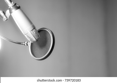gray scale tone the microphone in sound music room,select focus