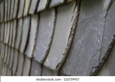 Gray schist roof tiles of an old house
