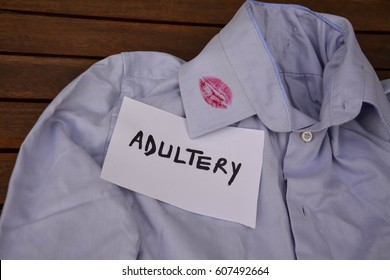 Gray shirt with kiss lipstick and adultery text on a white note